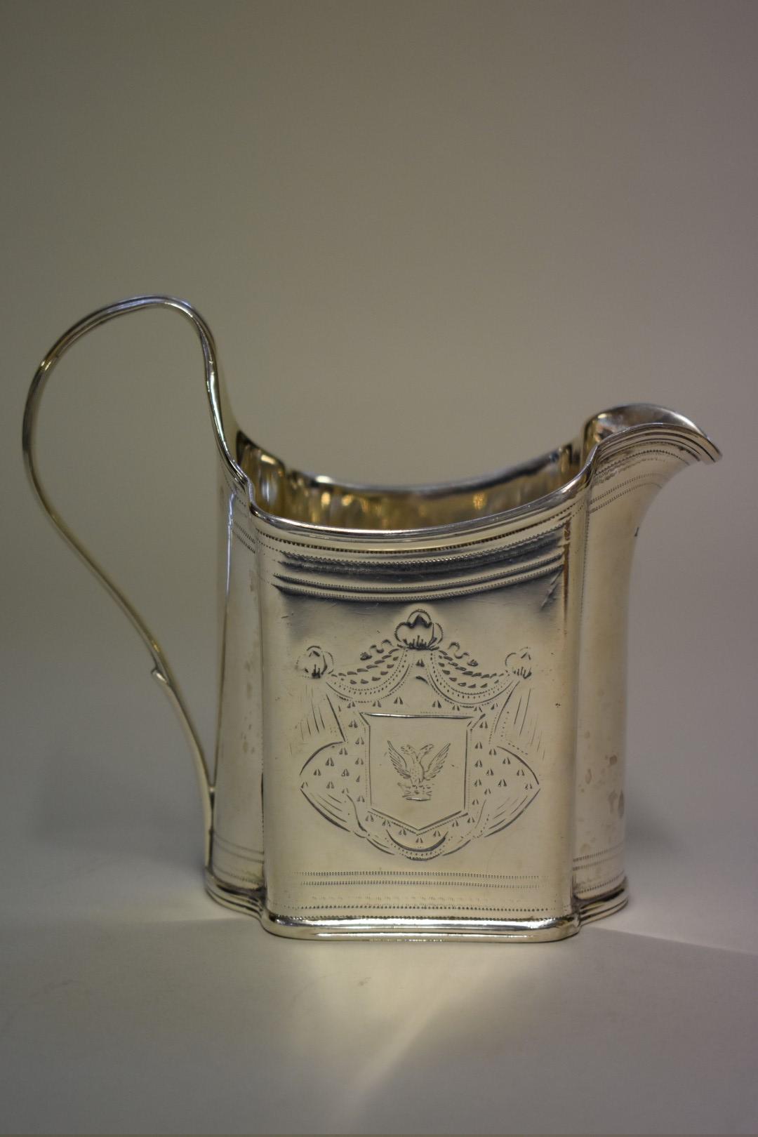 Lot 9 - A George III silver milk jug,makers mark indistinct, London 1793, 11.5cm high, 168g.