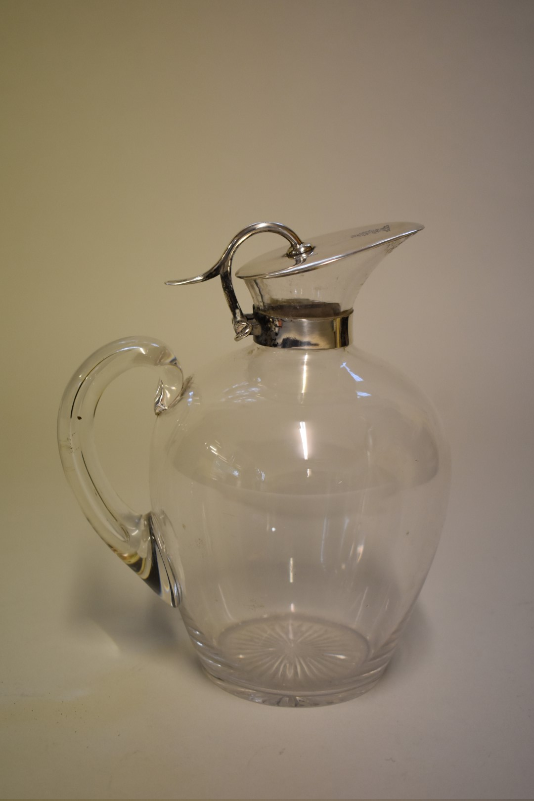 Lot 13 - A stylish Victorian silver mounted claret jug, makers mark indistinct, Birmingham 1893, 18.5cm high.