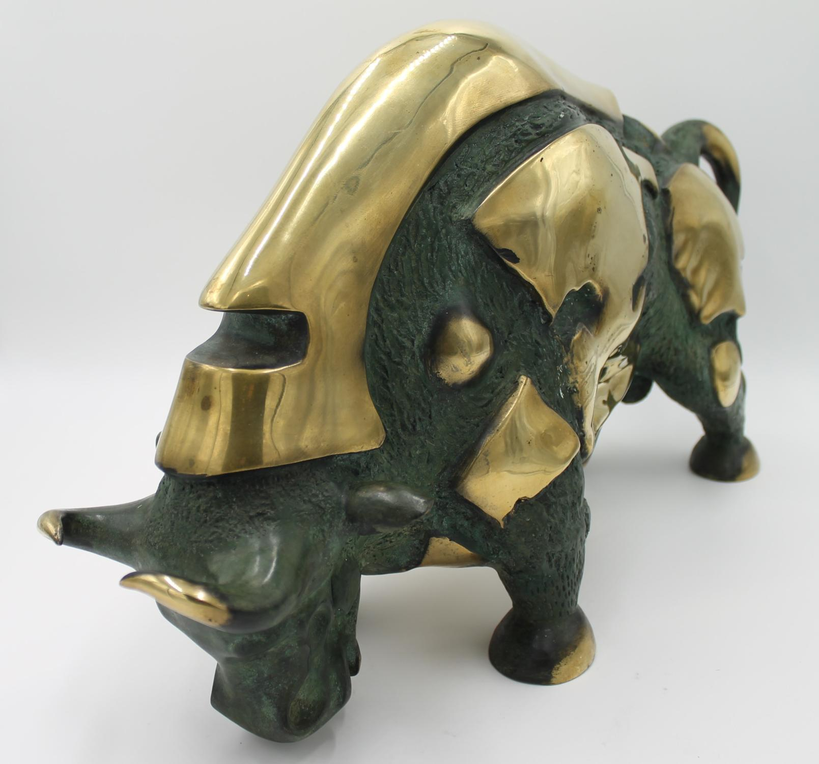 Lot 3 - Sculpture: A gilt and patinated bronze model of a Bull, 2nd half 20th century, with stylised