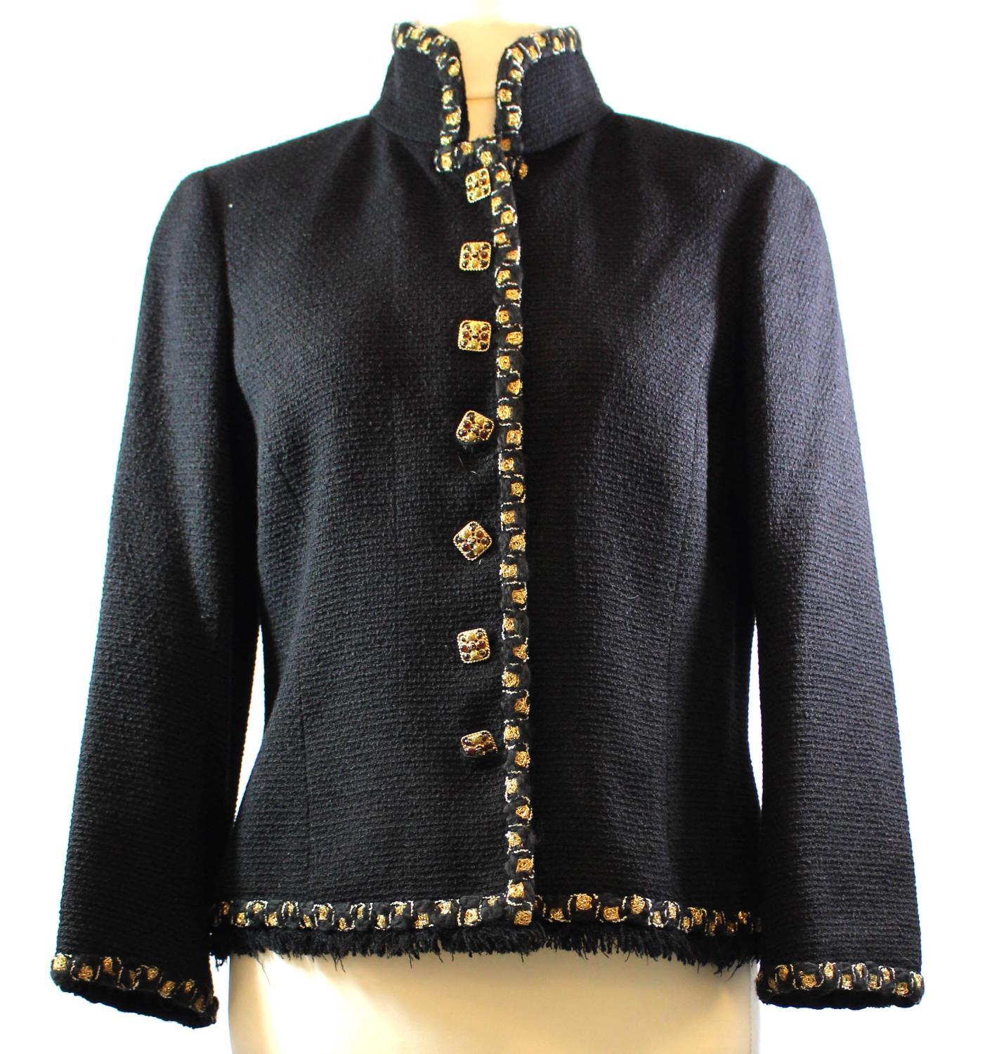 Lot 274 - CHANEL, BLACK TWEED TAILORED JACKET With fringed ends, gold and white embroidered detail and
