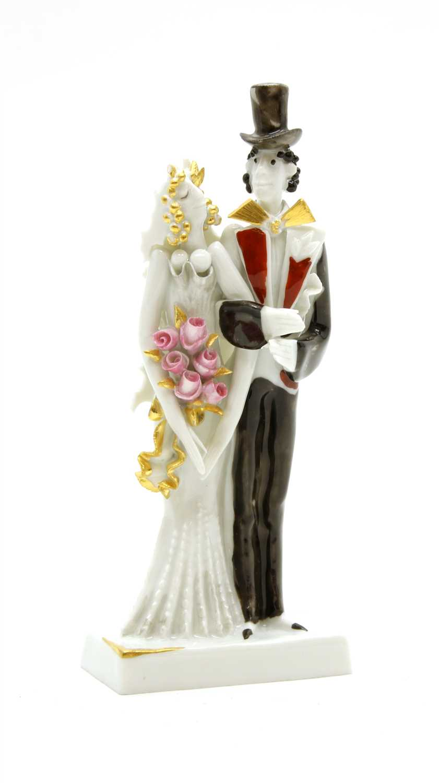 Lot 200 - A Meissen porcelain bride and groom figural group,