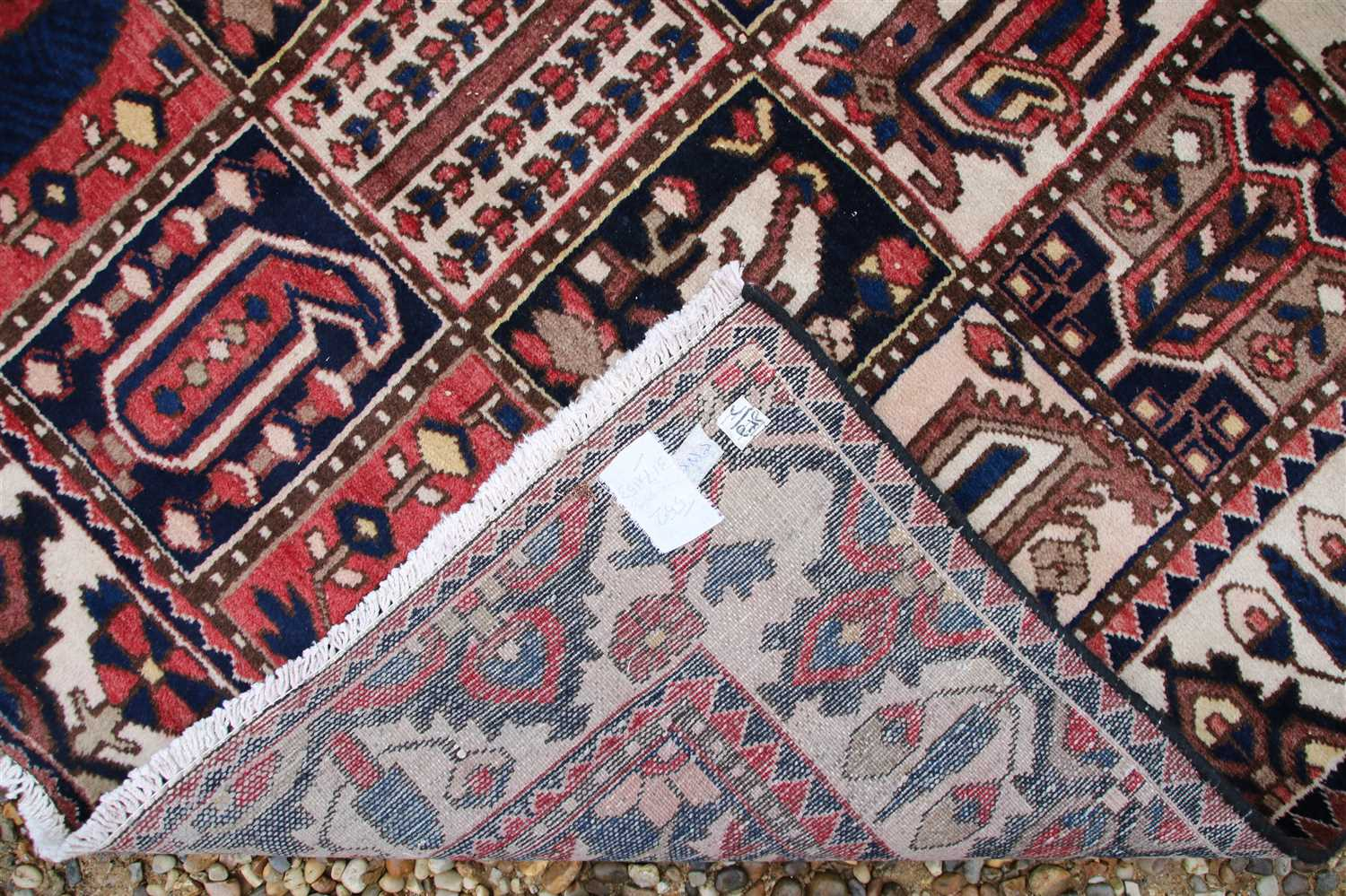 Lot 691 - Two ivory ground Caucasian rugs