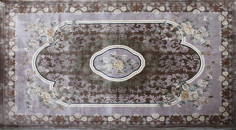 Lot 663 - A Kayan silk rug,