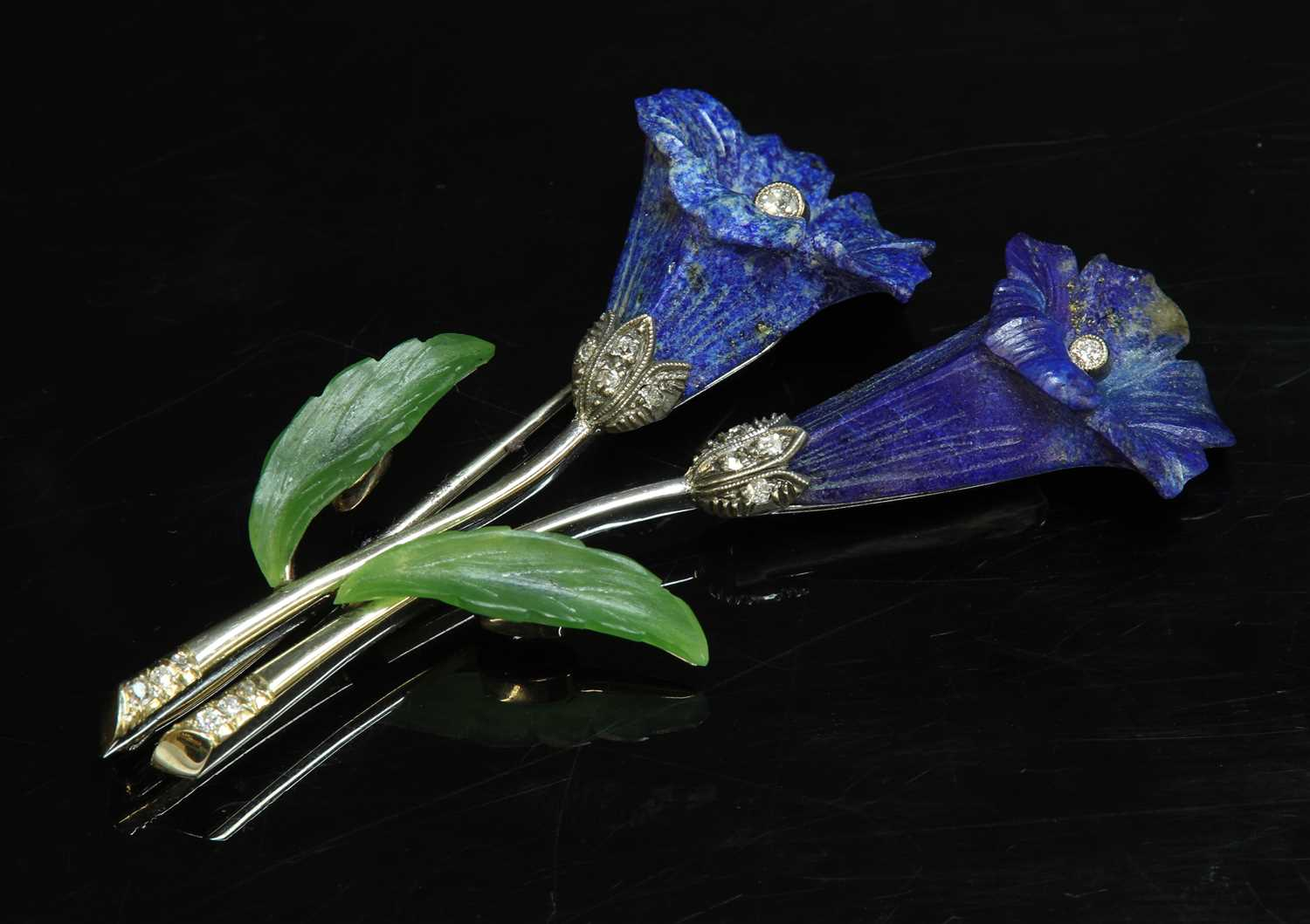 Lot 185 - A Continental white gold lapis lazuli, nephrite and diamond flower brooch,