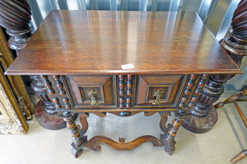 Lot 41 - OAK CABINET WITH SINGLE PANEL FRONT DRAWER ON TURNED SUPPORTS,