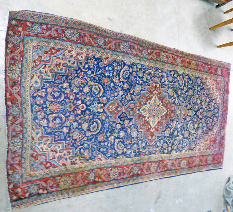 Lot 1170 - DEEP BLUE GROUND IRANIAN RUG OF KASHAN ORIGIN WITH ALL OVER FLORAL PATTERN AND CENTRAL MEDALLION