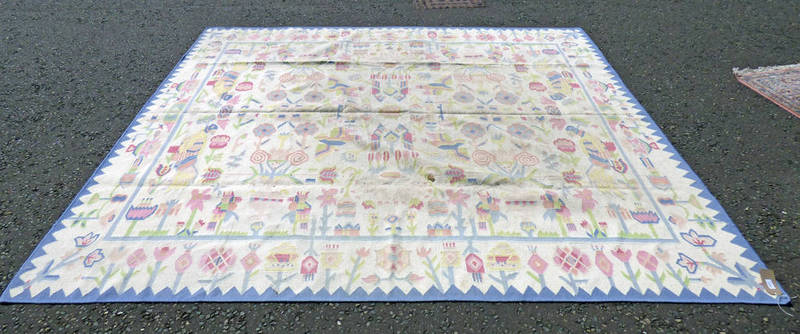 Lot 1058 - CREAM AND BLUE CARPET WITH FLORAL DECORATION 295 X 253 CM