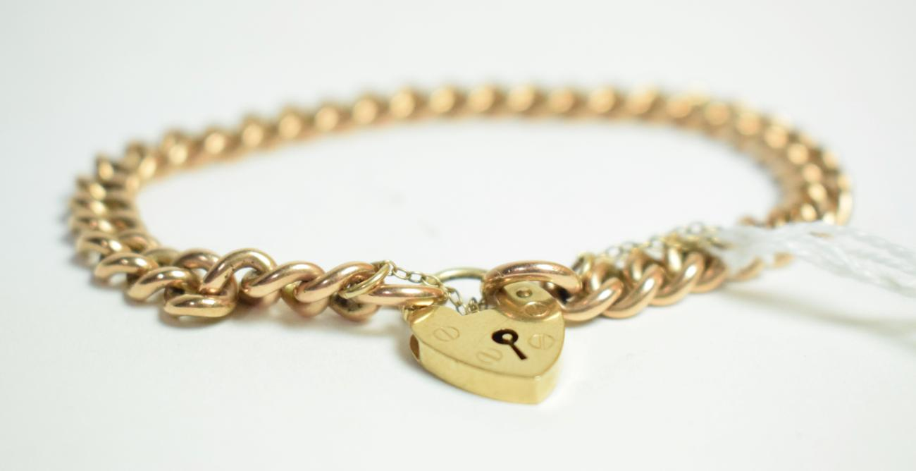 Lot 11 - A 9 carat gold bracelet, each link stamped '9' '.375', with later 9 carat gold padlock clasp, length