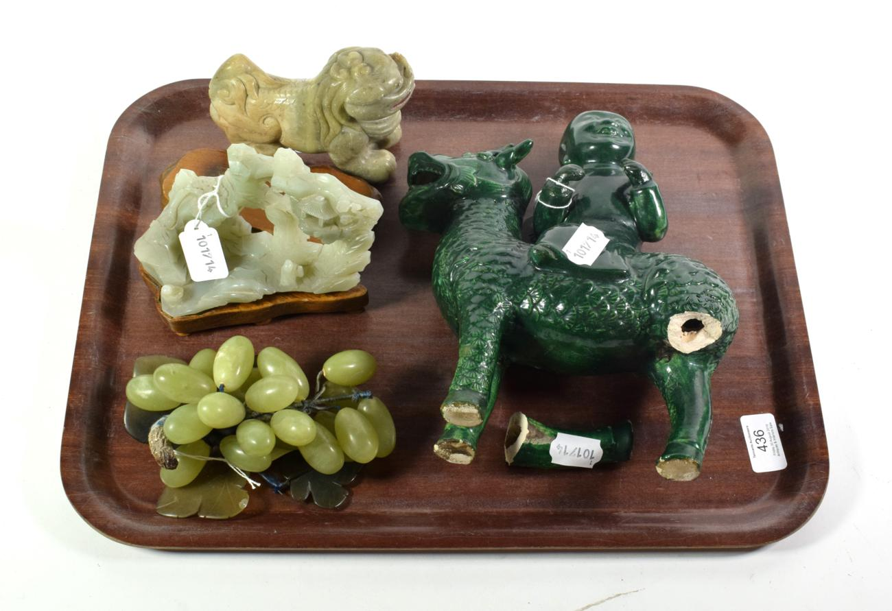 Lot 436 - A Chinese jade temple lion; with a jade landscape carving both with wooden stands; with two