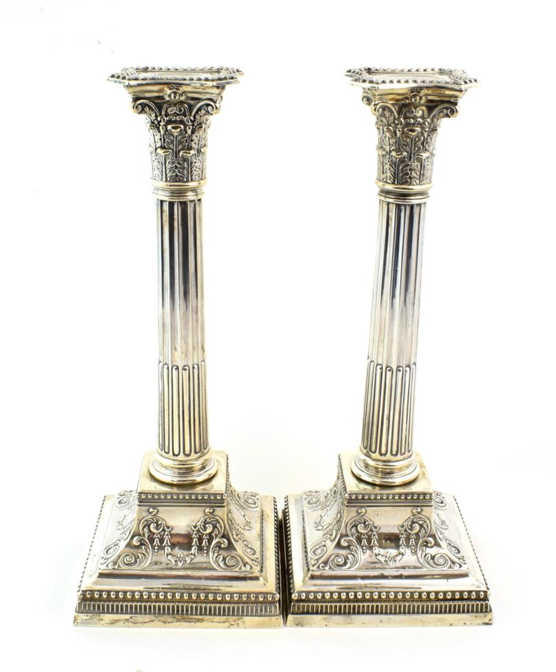 Lot 57 - A Pair of Victorian Silver Candlesticks, by James Dixon and Son, Sheffield, 1900, the square bases
