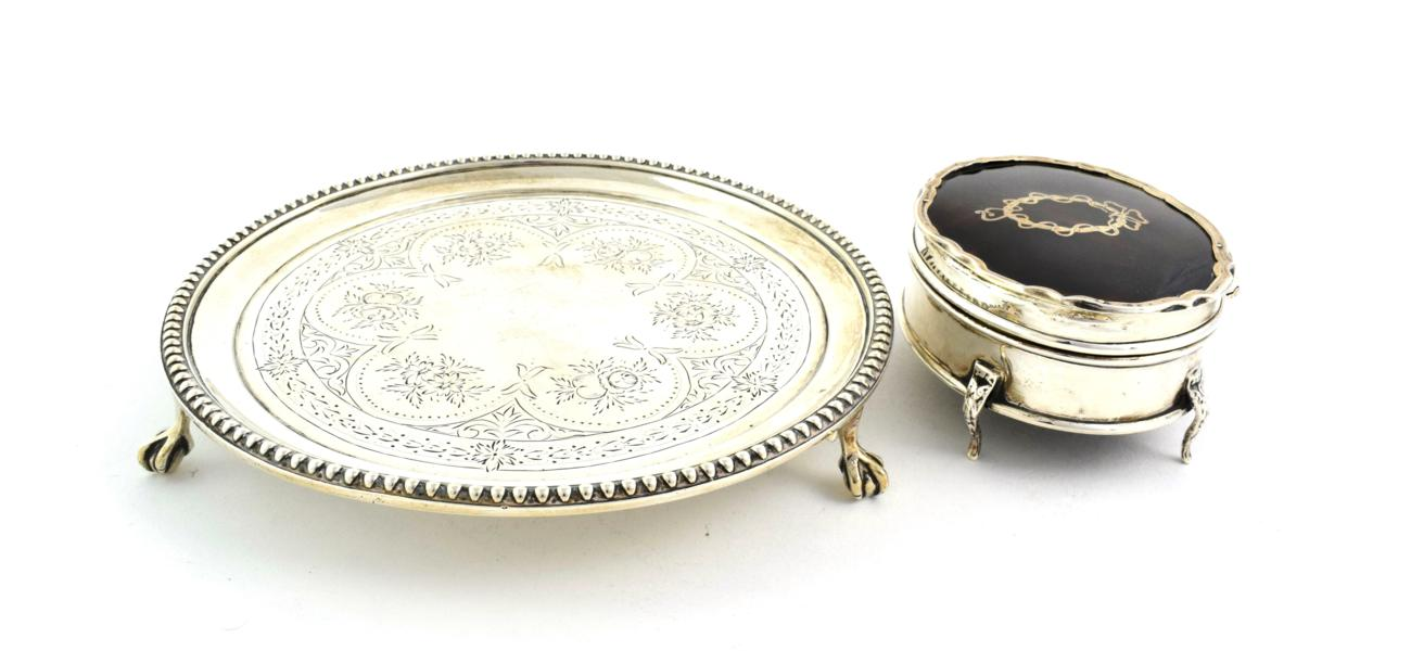 Lot 59 - A Victorian Silver Waiter, by Henry Holland, London, 1873, circular and with beaded border, on three
