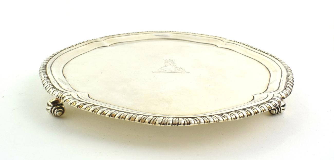 Lot 14 - A George III Silver Waiter, by John Carter, London, 1771, shaped circular and with gadrooned rim, on