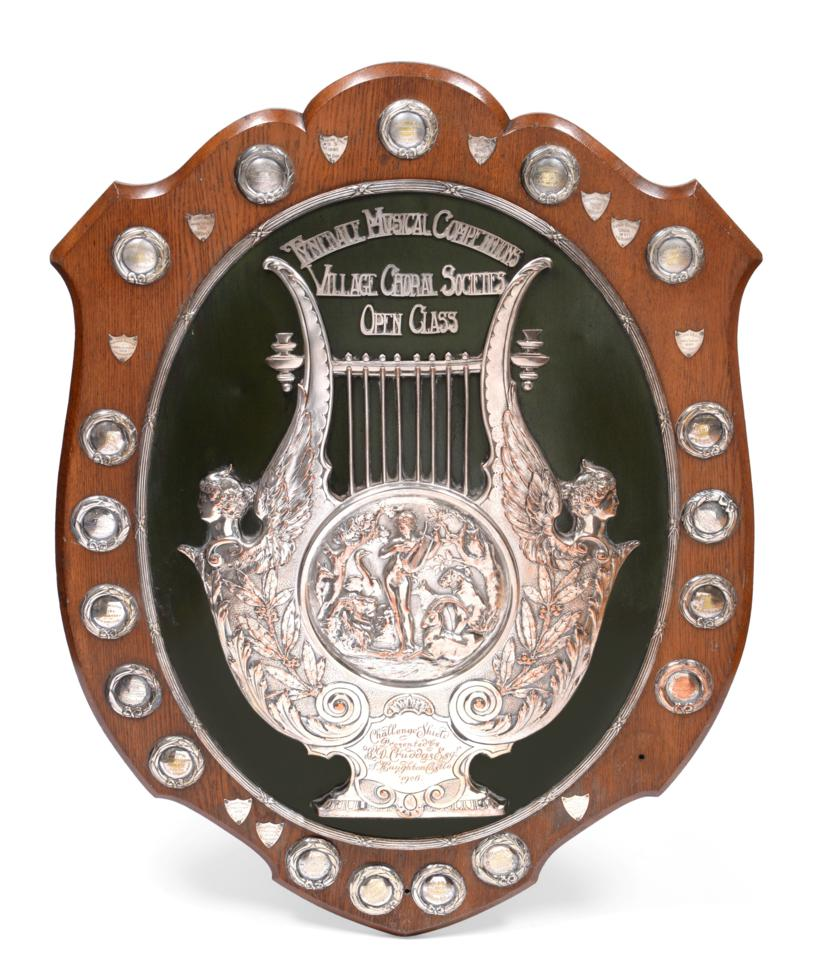 Lot 9 - An Edward VII Silver-Plated Choral Shield, by Elkington, Dated 1908, the oak support with easel back
