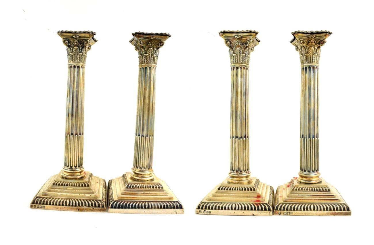 Lot 54 - Four Victorian Silver Candlesticks, Three by William Gibson and John Langman, Two Sheffield, 1897,