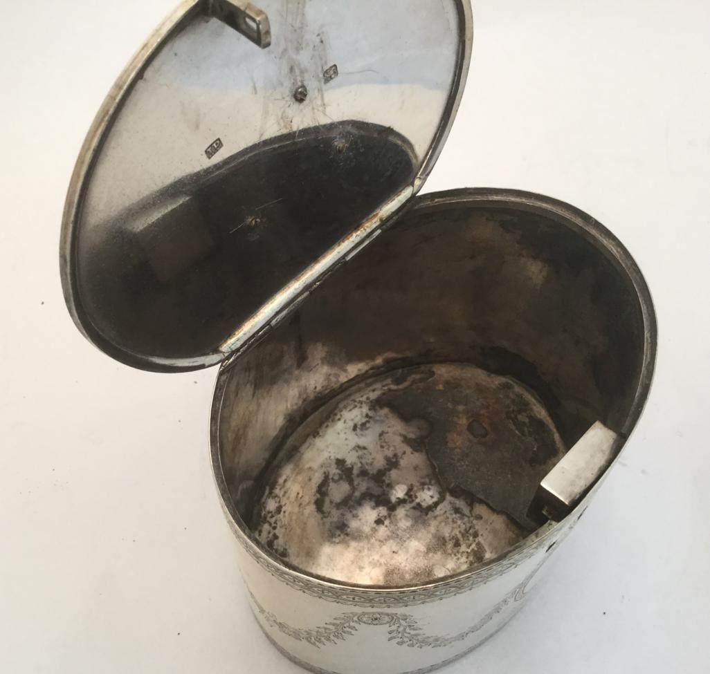 Lot 100 - A George III Silver Tea-Caddy, Maker's Mark IP, Probably for Joseph Preedy, London, 1776, oval and