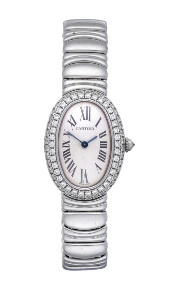 Lot 191 - A Lady's 18ct White Gold Diamond Set Wristwatch, signed Cartier, model: Baignoire Joaillerie, ref: