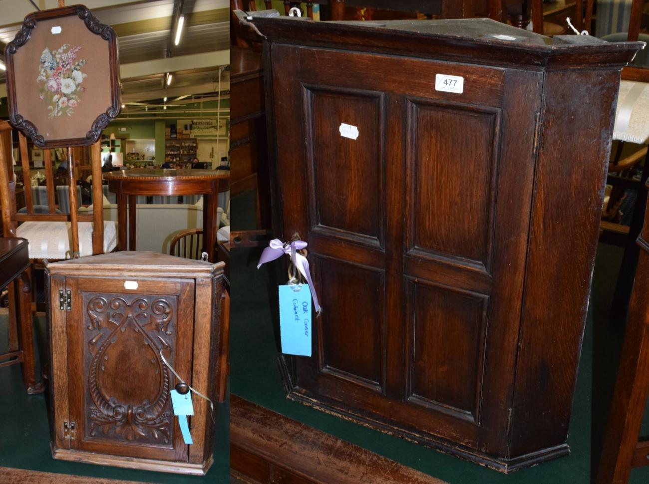 Lot 477 - A Victorian walnut pole screen; a carved oak and pine small corner cupboard; and another oak