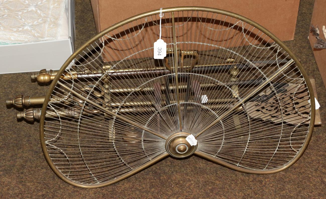 Lot 394 - A 19th century brass fire screen together with a set of fire tools and andirons