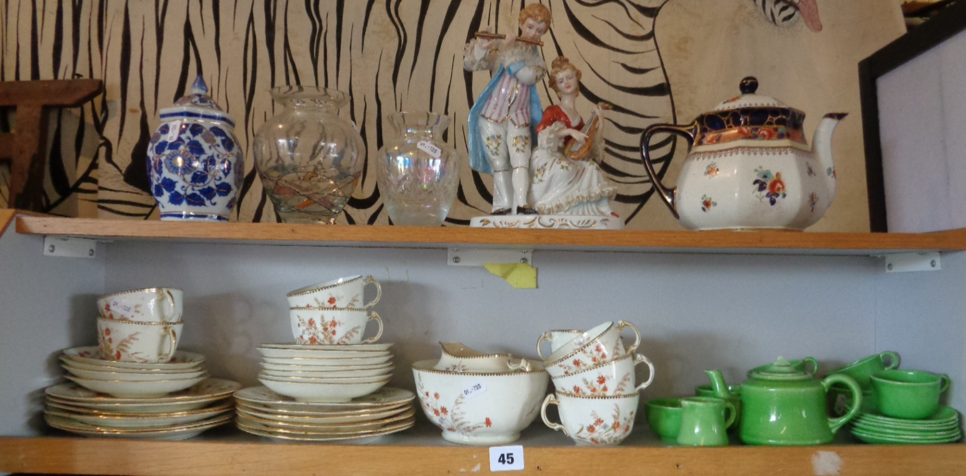 Lot 45 - Two shelves of china and glassware, inc. child's tea set