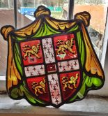 Lot 26 - Antique stained and painted glass heraldic shield (A/F)