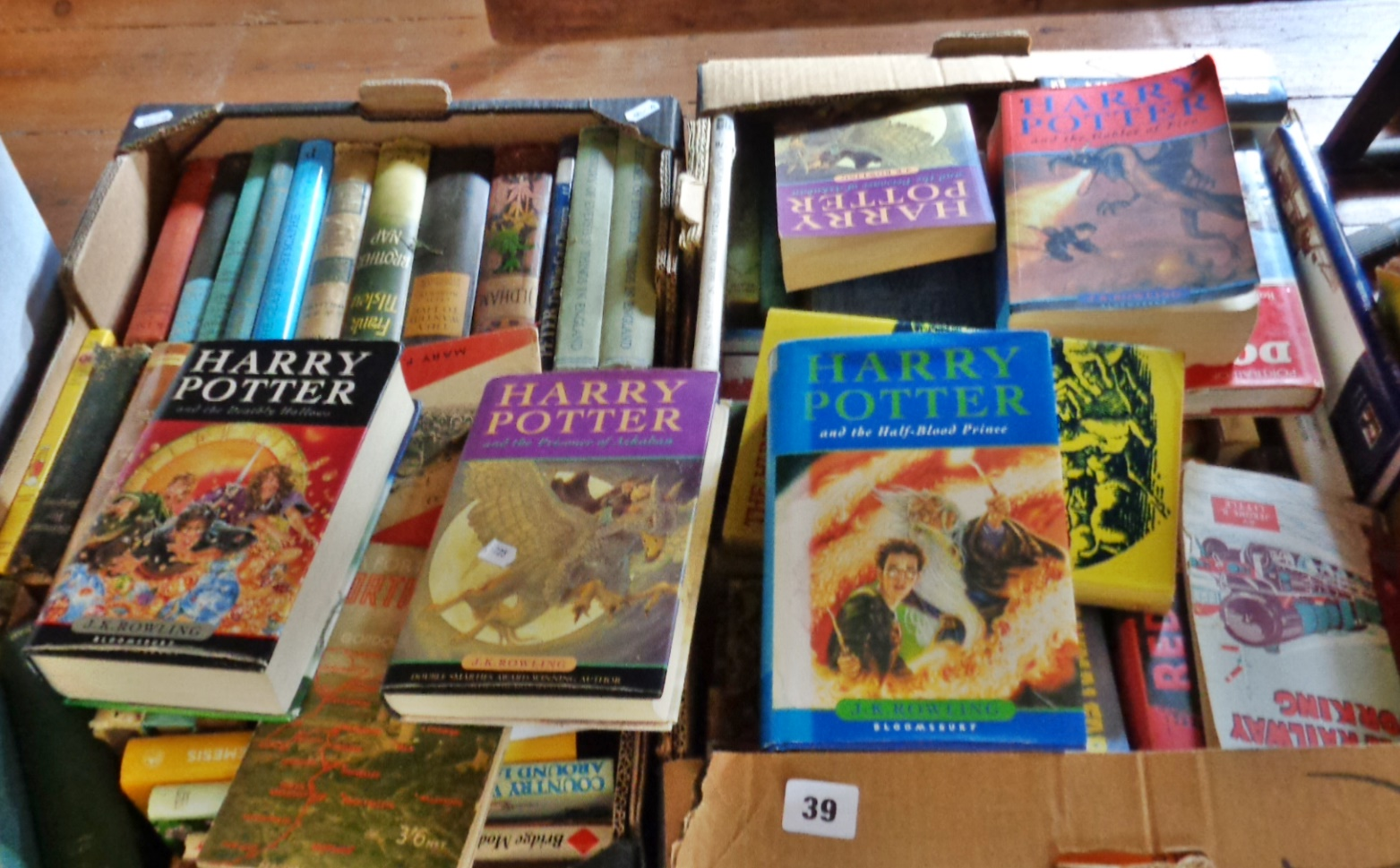Lot 39 - Two boxes of paperback and hardback books, inc. Harry Potter, 1st Editions