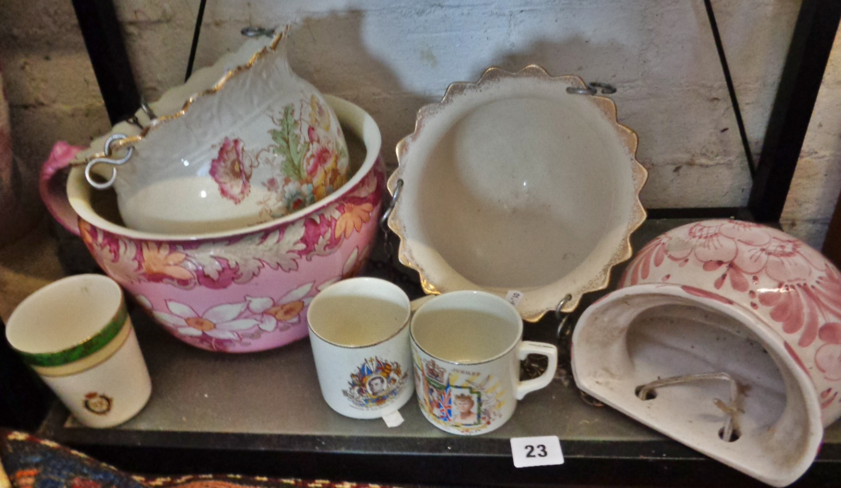 Lot 23 - Pair of Victorian floral painted china hanging jardinieres, a pink floral decorated chamber pot,