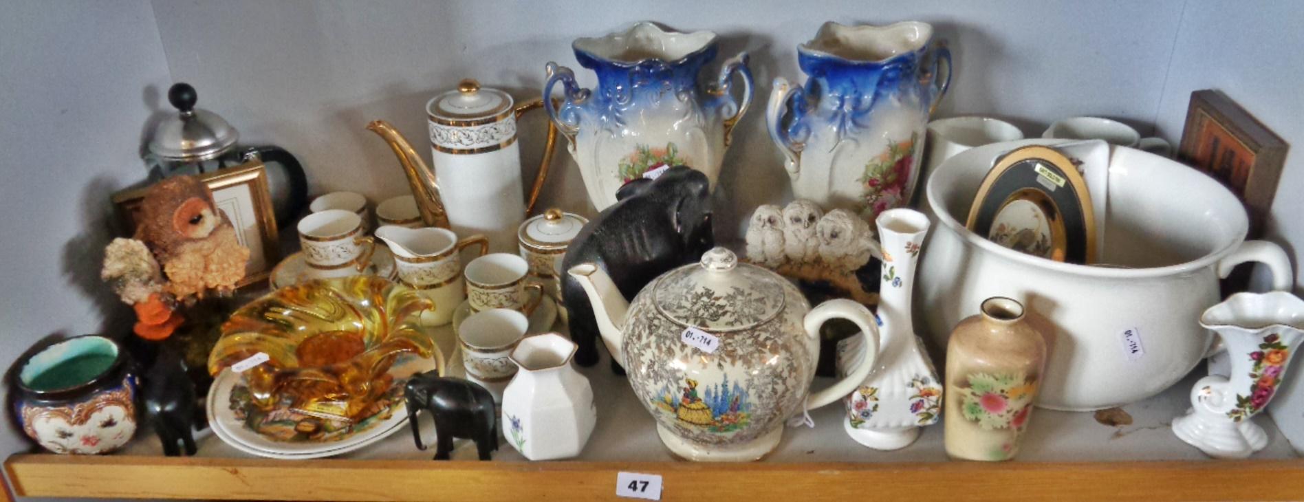 Lot 47 - Porcelain coffee set, owl figurines, carved elephants, etc. (one shelf)