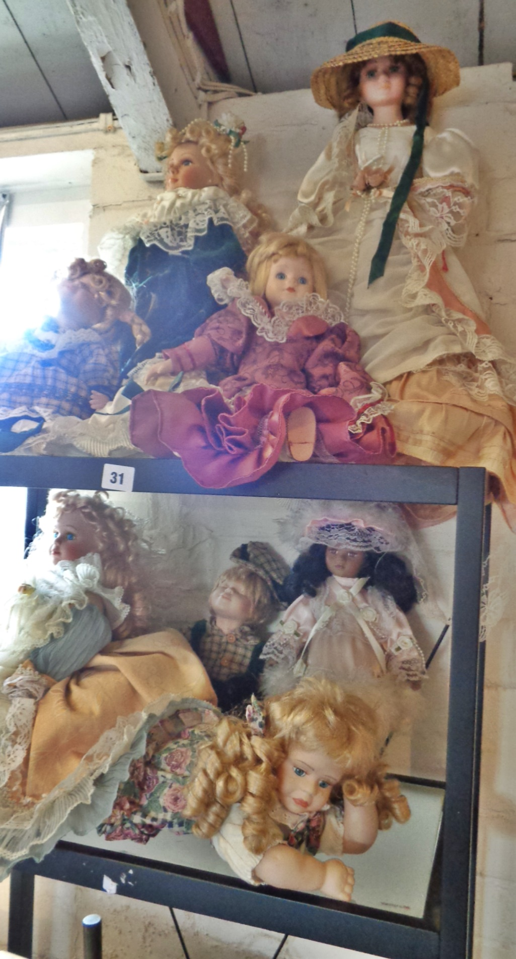 Lot 31 - Two shelves of contemporary china dolls (8)