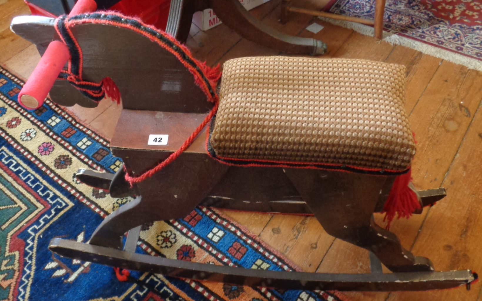 Lot 42 - Child's wooden rocking horse