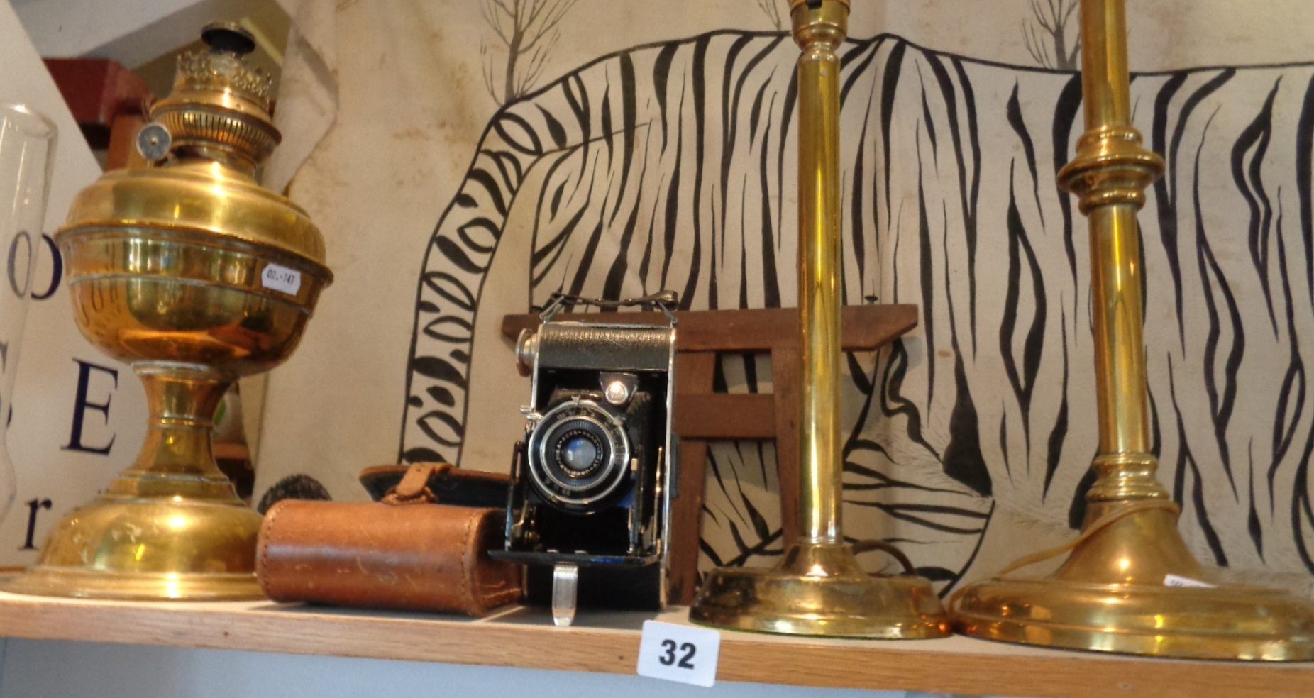 Lot 32 - Old Agfa bellows camera with leather case, brass table lamps, etc.