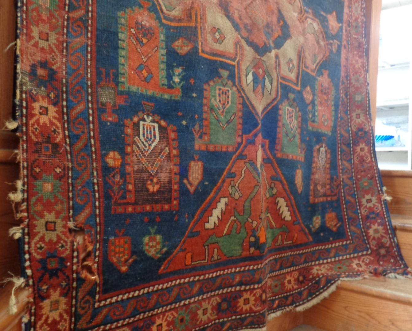 "Lot 1 - Antique Persian rug (some holes), approx 52"" x 100"""