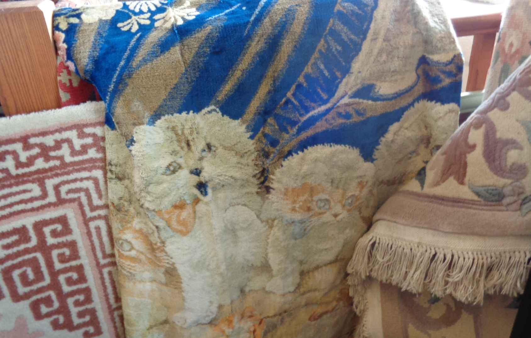 Lot 4 - Two wool rugs or carpets and a kitten wall-hanging