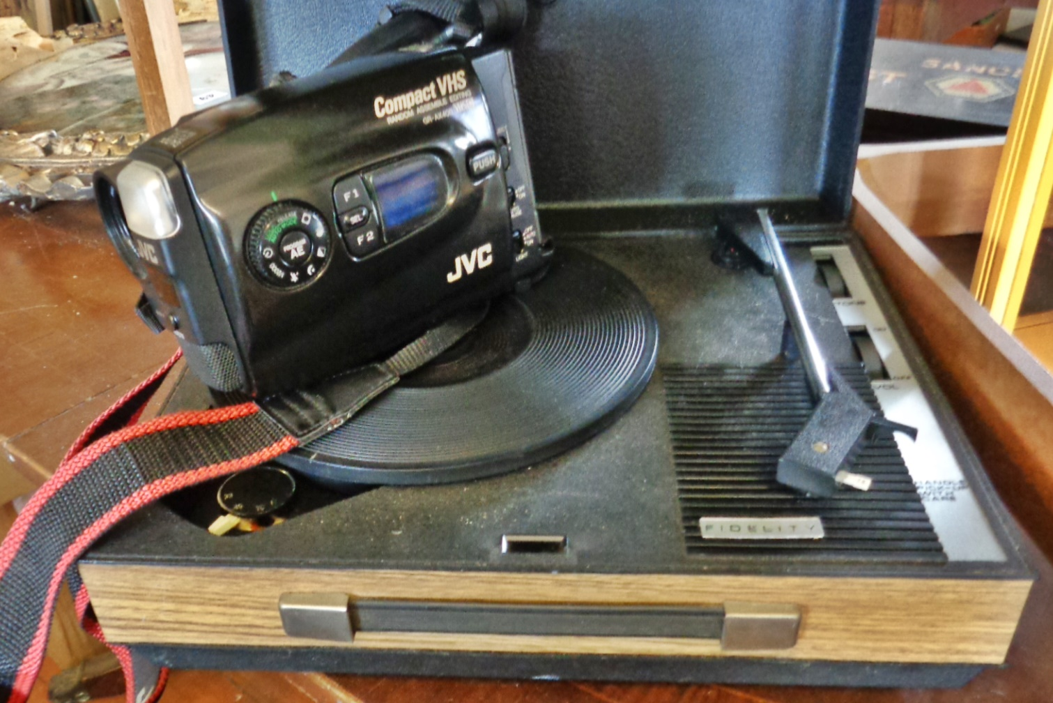 Lot 50 - JVC Compact VHS GR-AX400 video camera and a vintage Fidelity record player or turntable in case