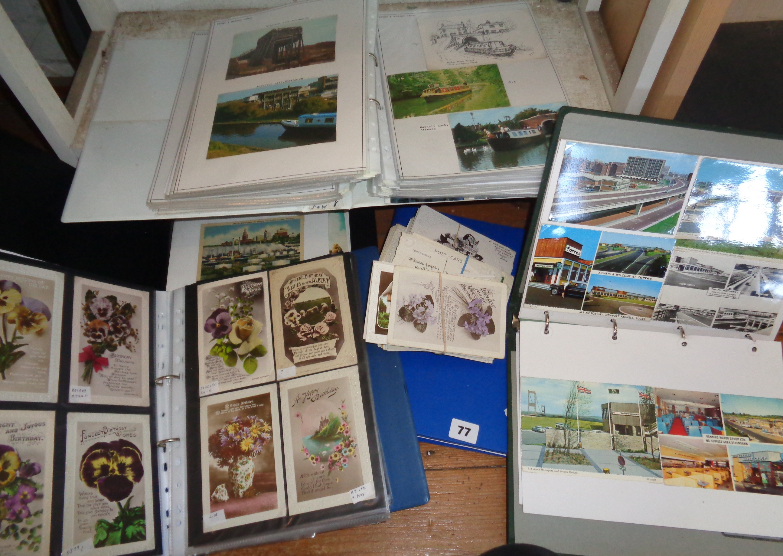 Lot 77 - Five folders of postcards and some loose including greetings and holiday camps