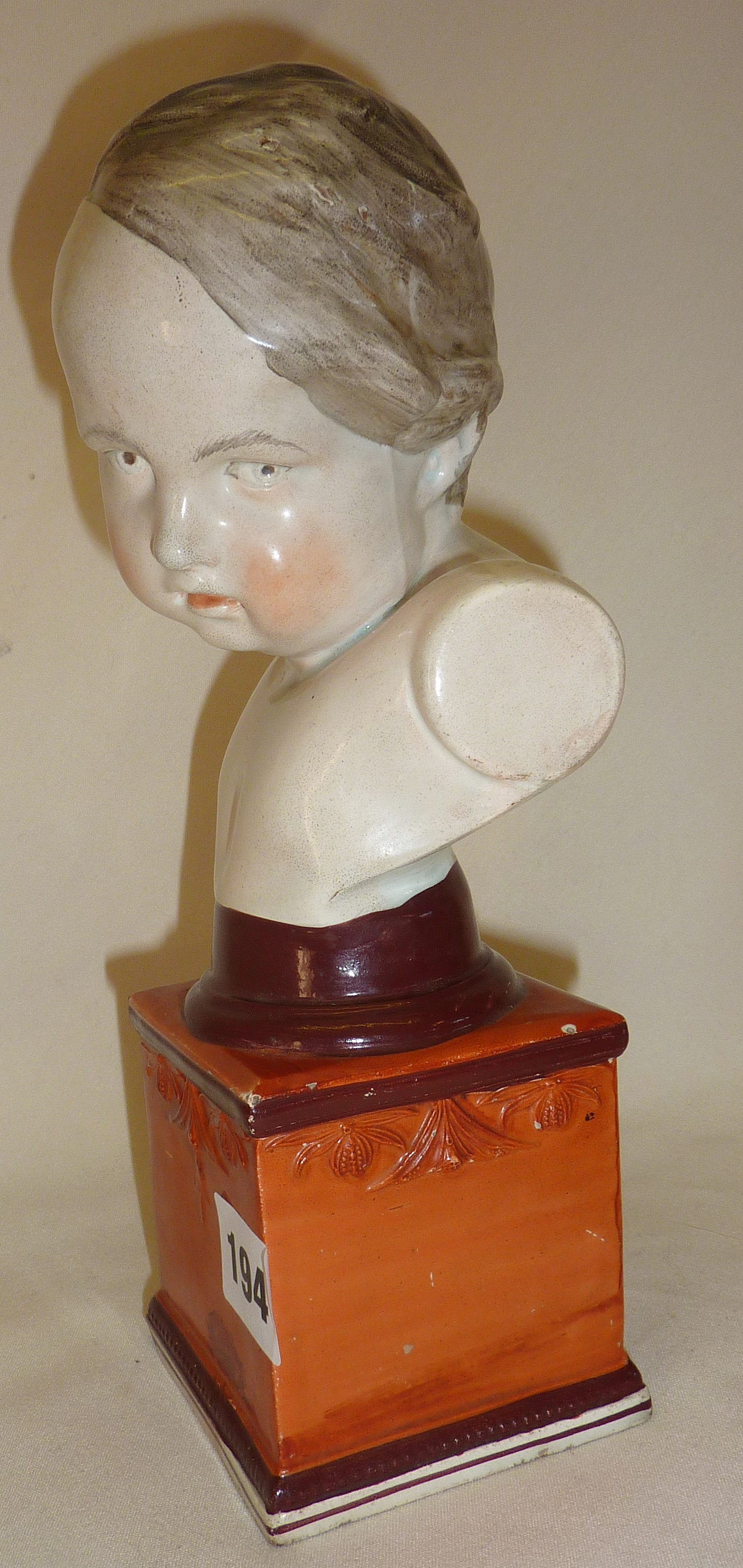 """Lot 194 - Staffordshire pearlware bust of a young boy, circa 1800, approx, 10.5"""" high"""