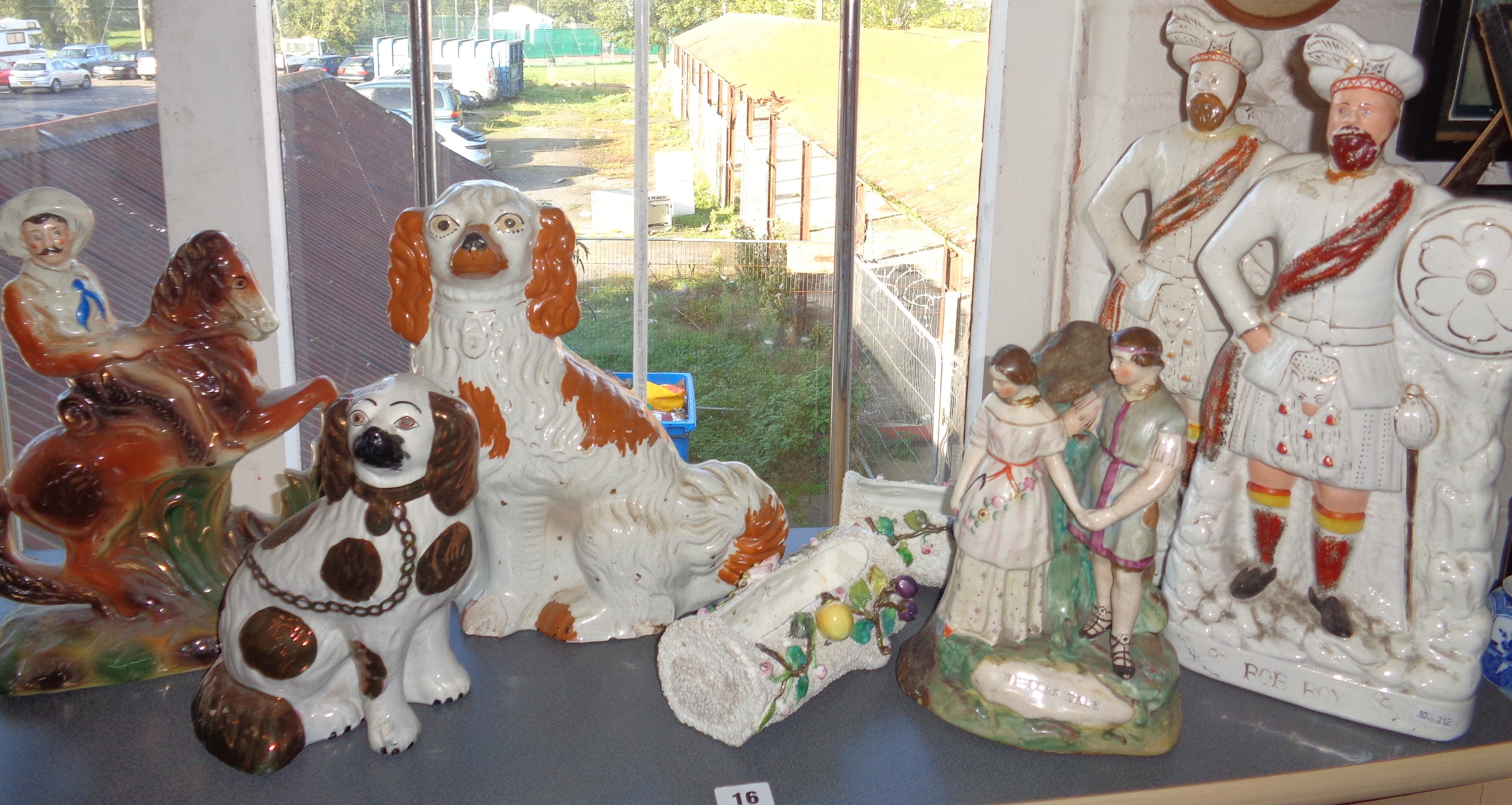 Lot 16 - Three Staffordshire groups (A/f), two Staffordshire dogs and three others
