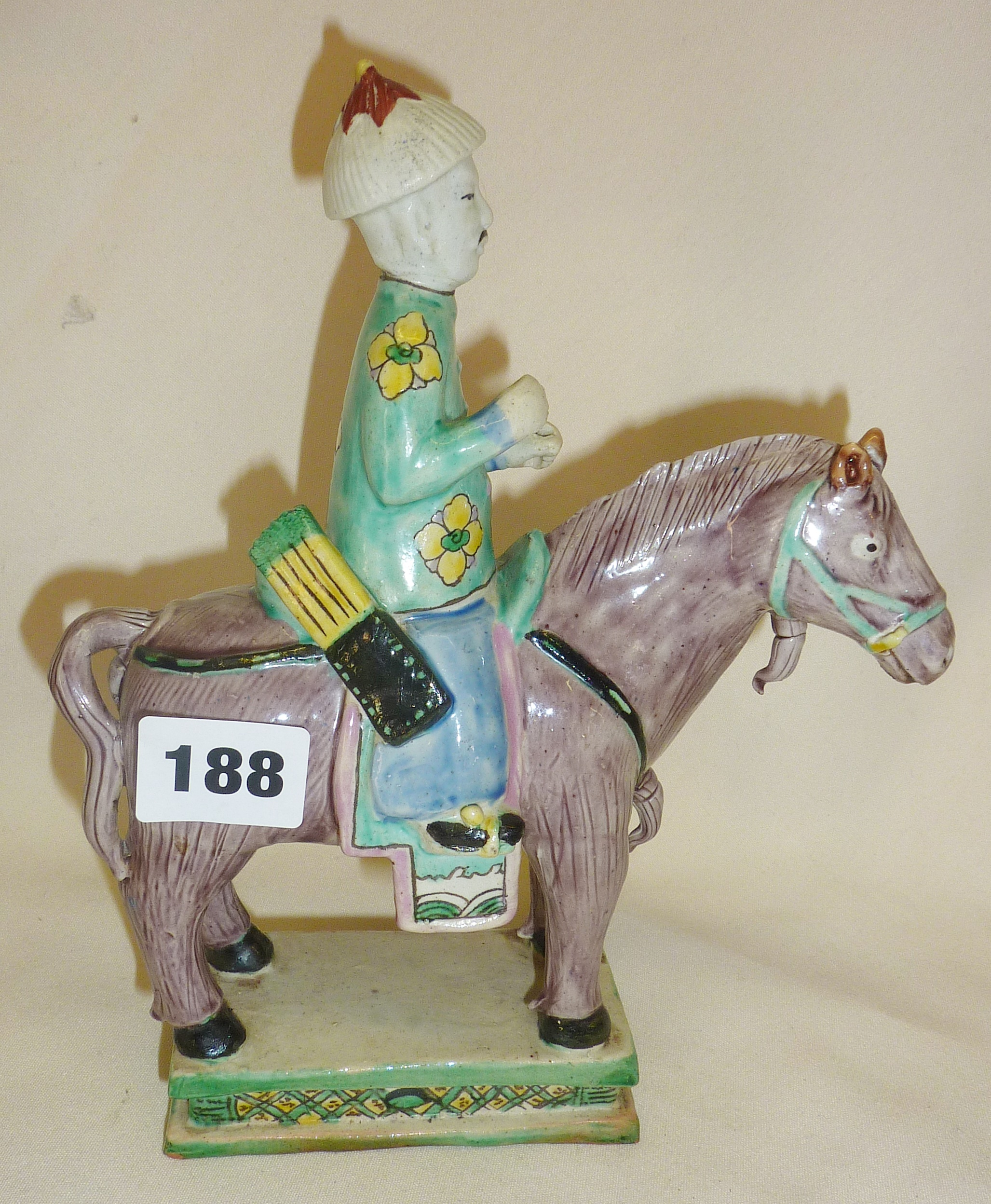 """Lot 188 - Chinese pottery polychrome figure on a horse, approx. 9"""" high"""