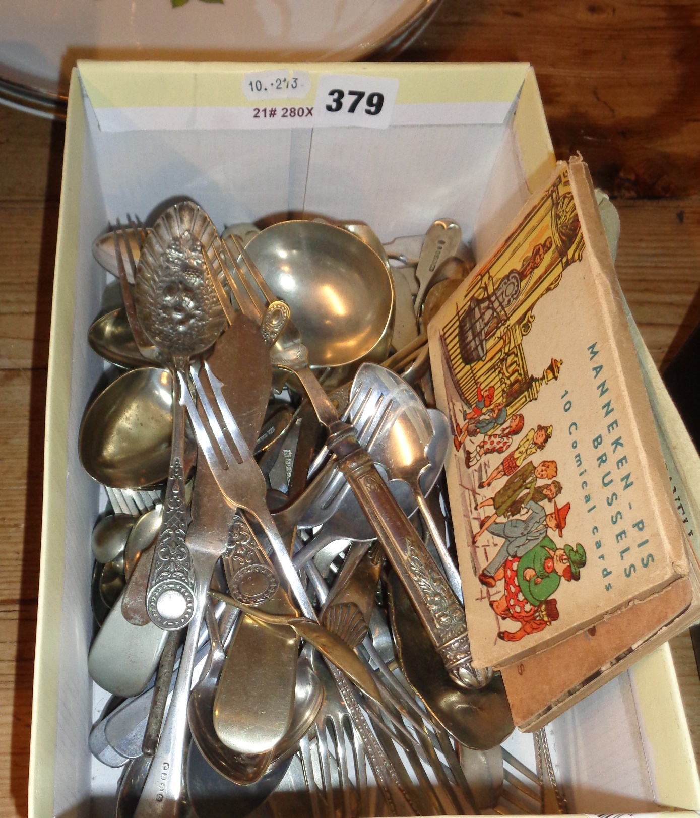 Lot 379 - Box of silver plated cutlery and comical postcards