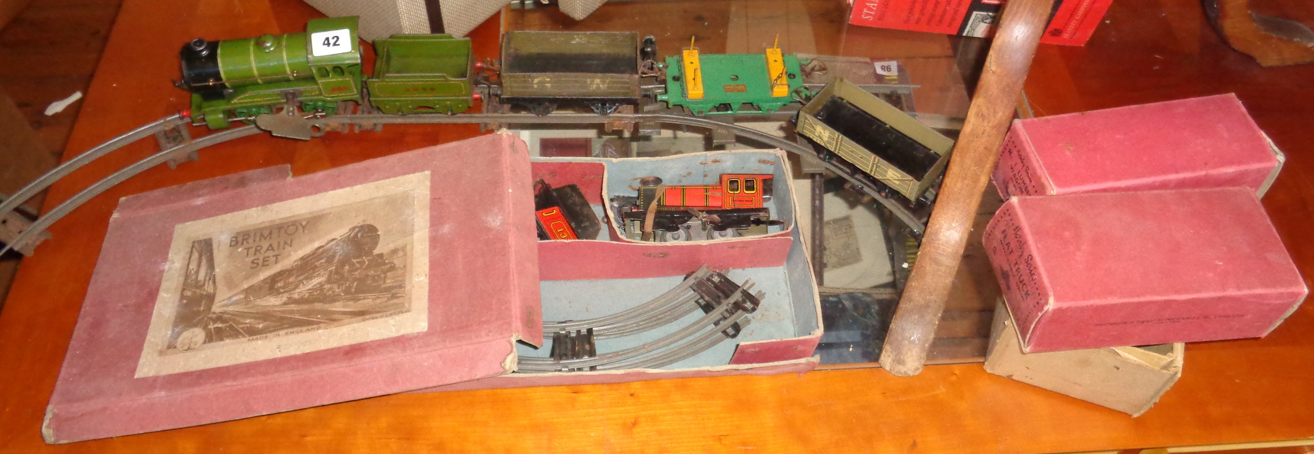 Lot 42 - Hornby 0 gauge L.N.E.R locomotive and goods wagons (3), two boxed, and a Brimtoy Tinplate Train