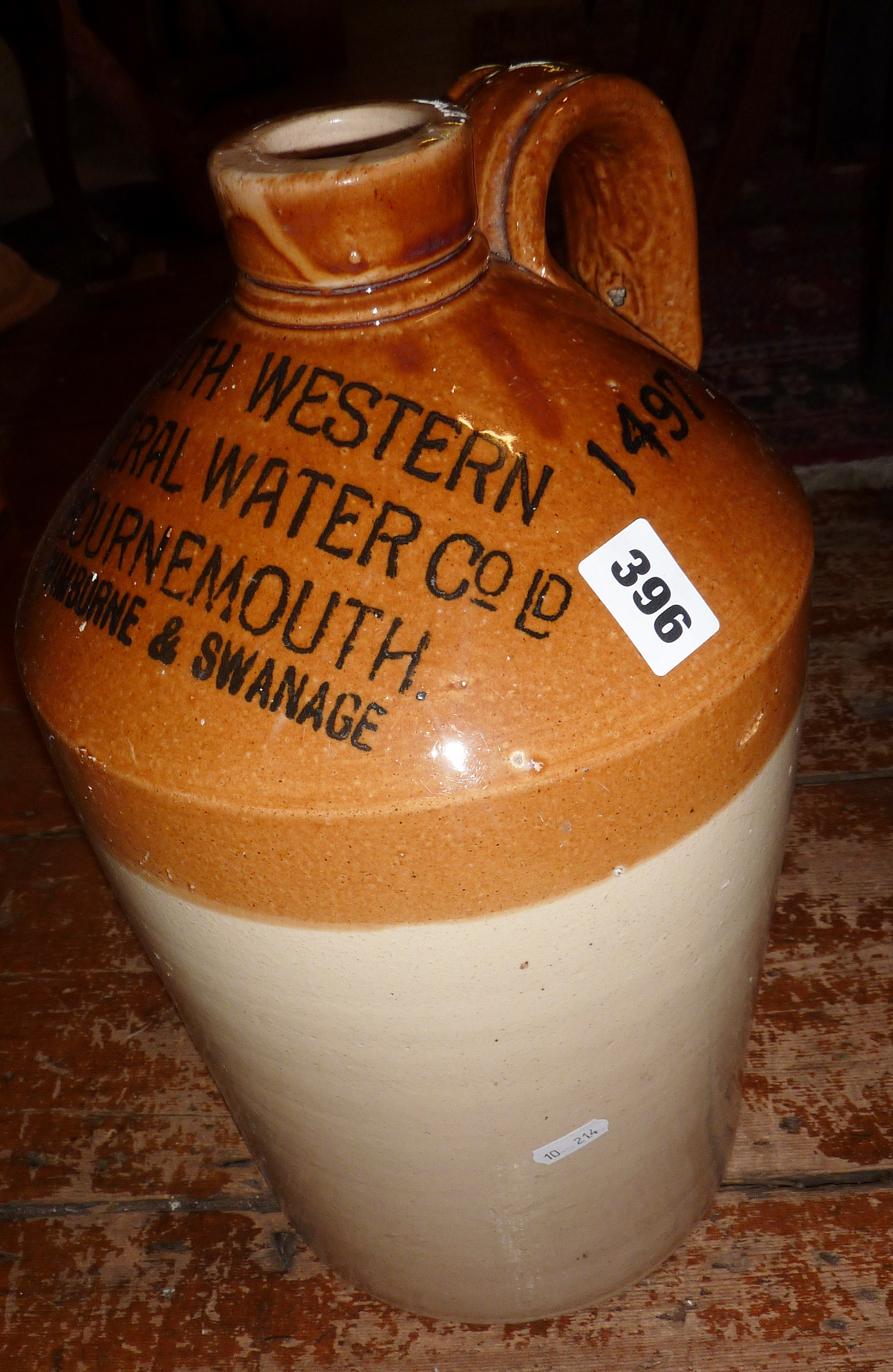 Lot 396 - Stoneware flagon with black legend 'SOUTH WESTERN MINERAL WATER CO LTD, BOURNEMOUTH WIMBORNE &