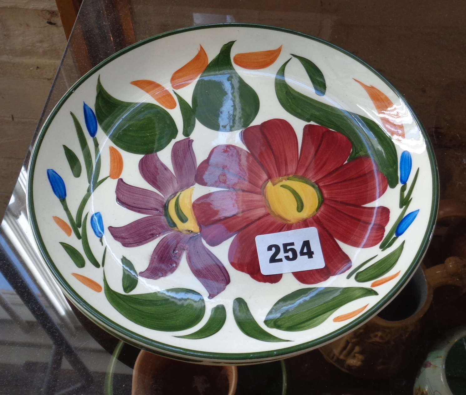 Lot 254 - Two hand painted floral Wade plates
