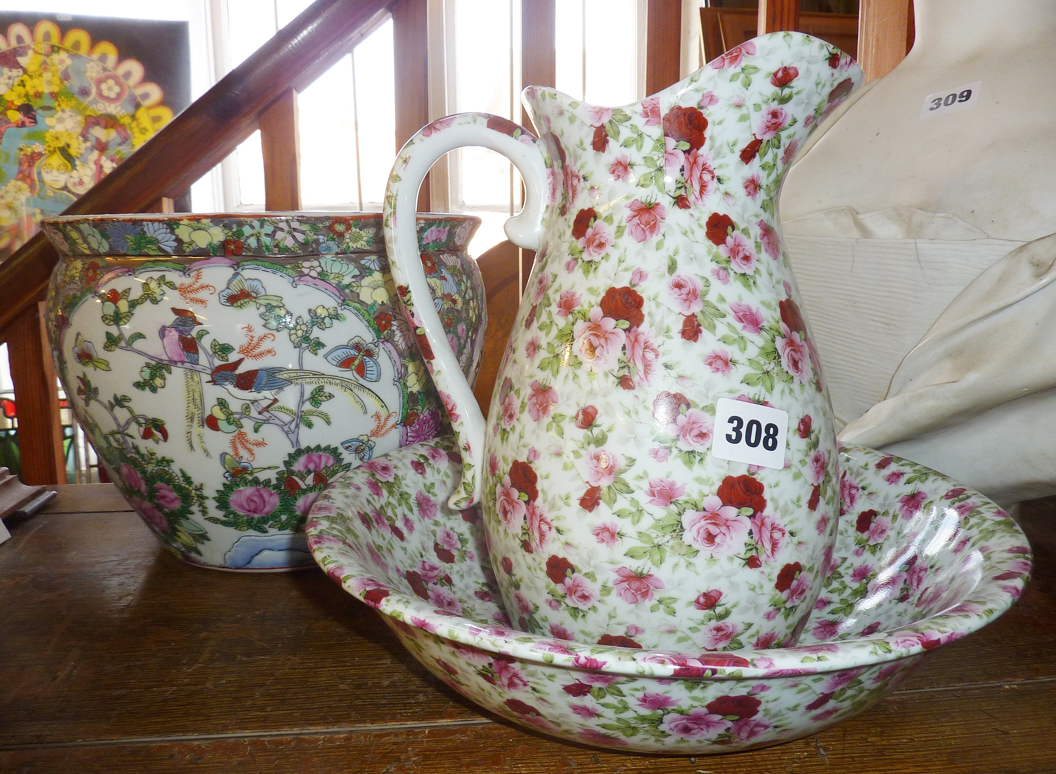 Lot 308 - Floral decorated jug and basin and a modern Oriental fish bowl planter