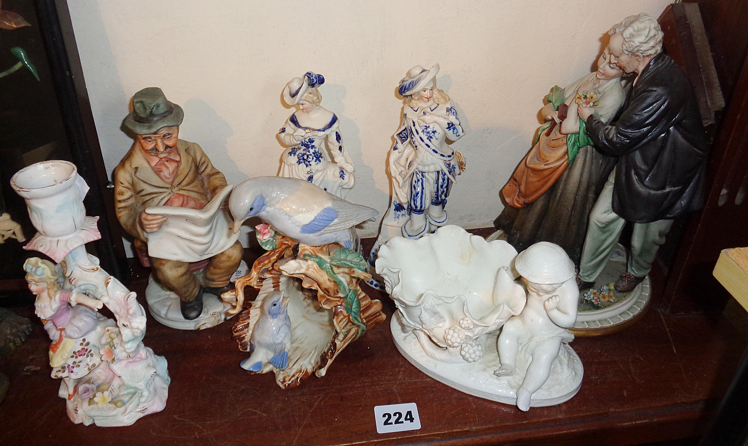 Lot 224 - Continental porcelain bird ornament, three similar figures and three others