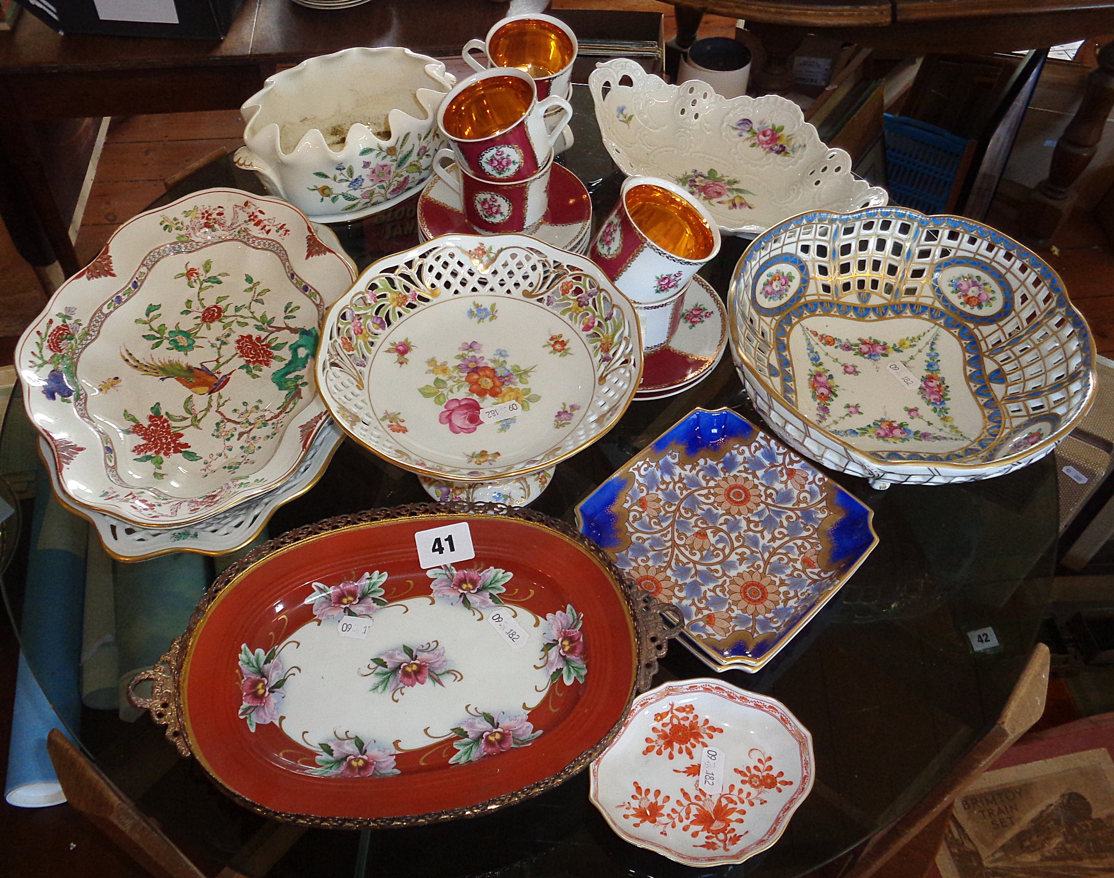 Lot 41 - Czechoslovakian gilded teacups, Dresden pierced bowl on legs, a Minton china flower vase, two signed