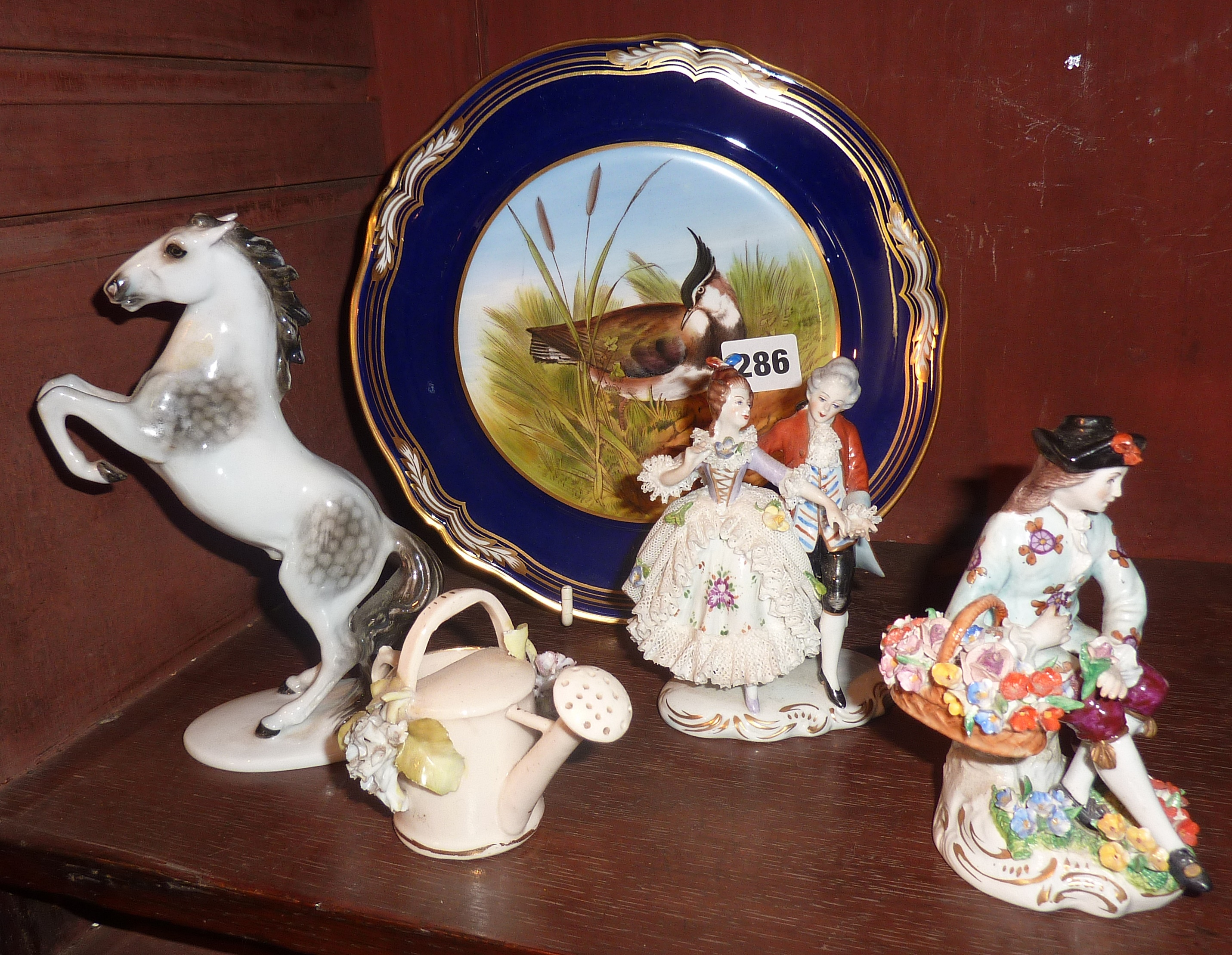 Lot 286 - Continental porcelain figures, bird plate, etc.
