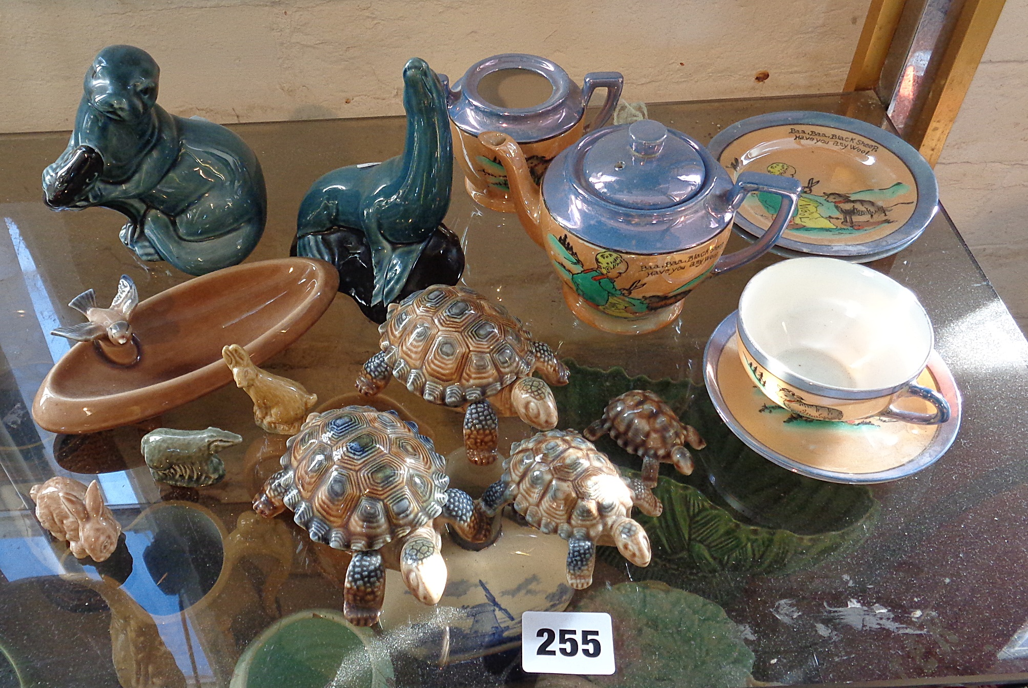 Lot 255 - Two Poole Pottery Seals, some Wade tortoises and a Japanese china child's teaset