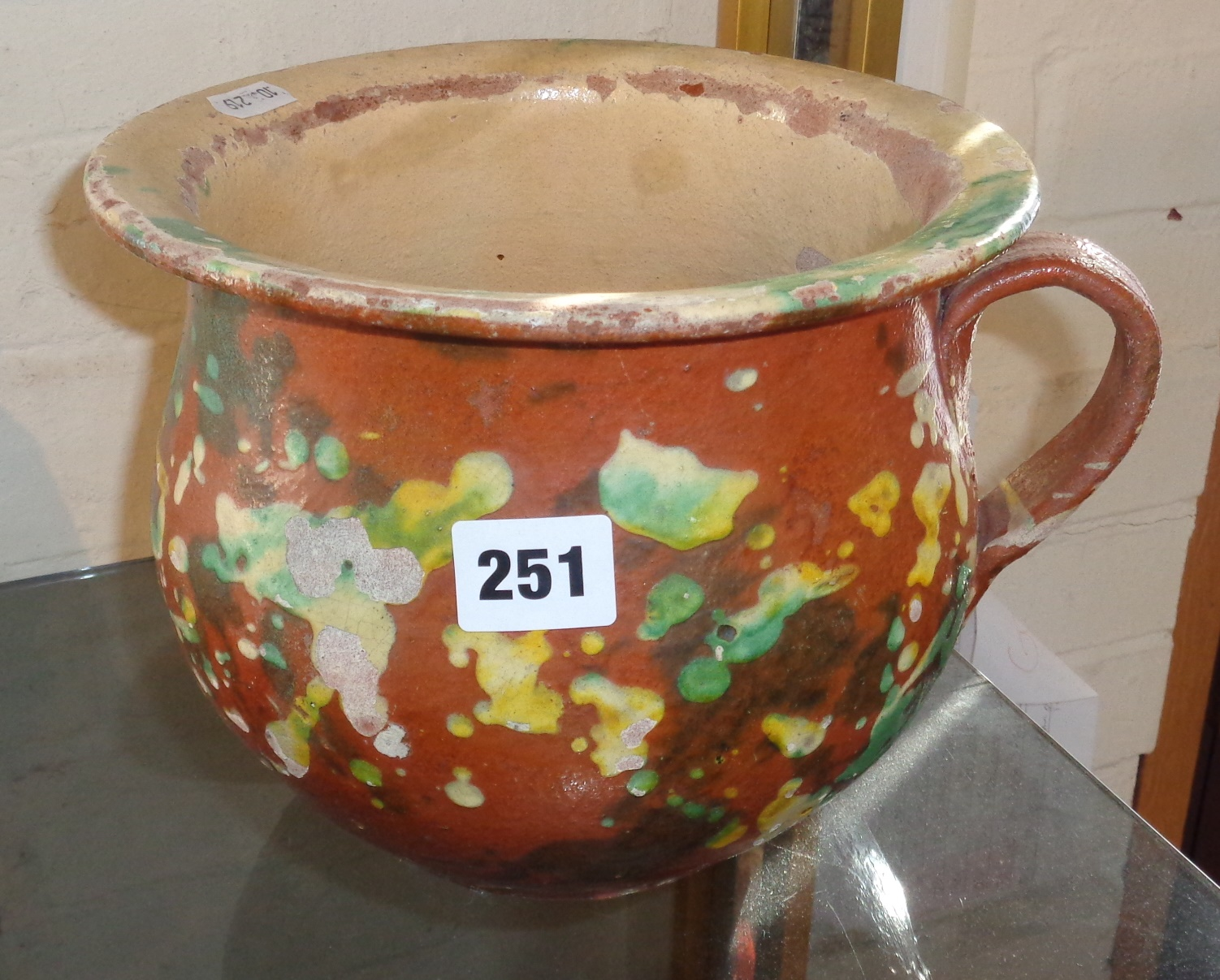 "Lot 251 - 17th/18th century terracotta chamber pot, with spatterware decoration, 7"" high x 9"" dia. with"
