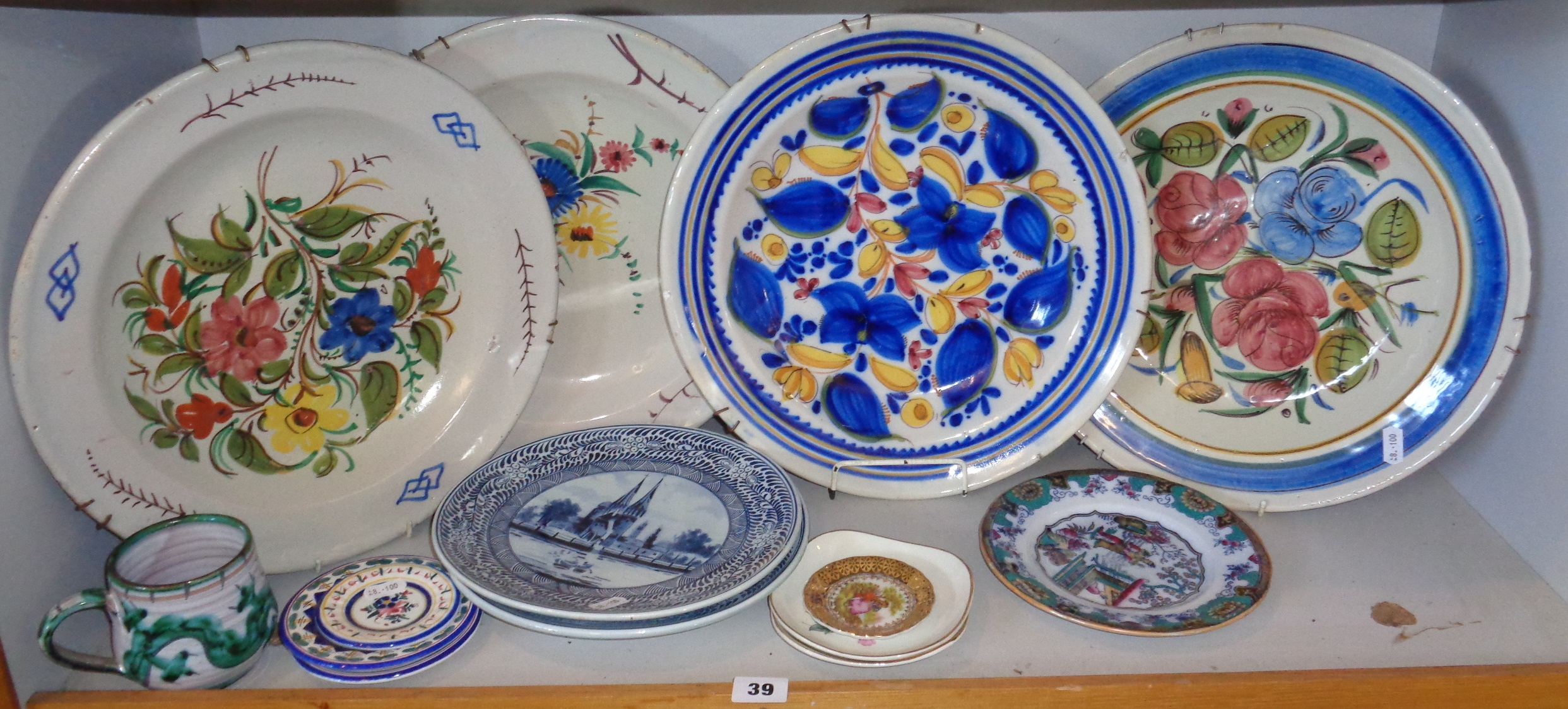 "Lot 39 - Four Continental polychrome floral tin glaze chargers (one marked verso ""J.C."") and other ceramics"