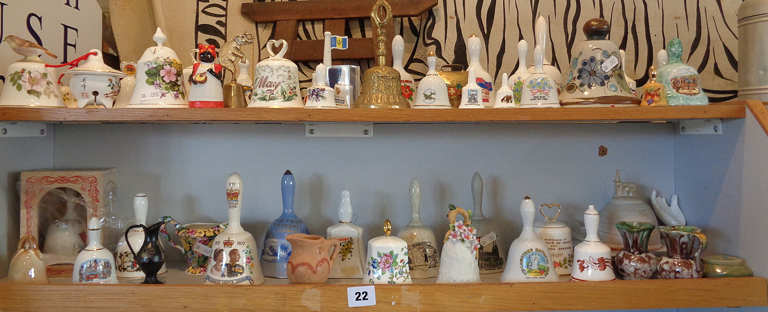Lot 22 - Large collection (two shelves) of china hand bells