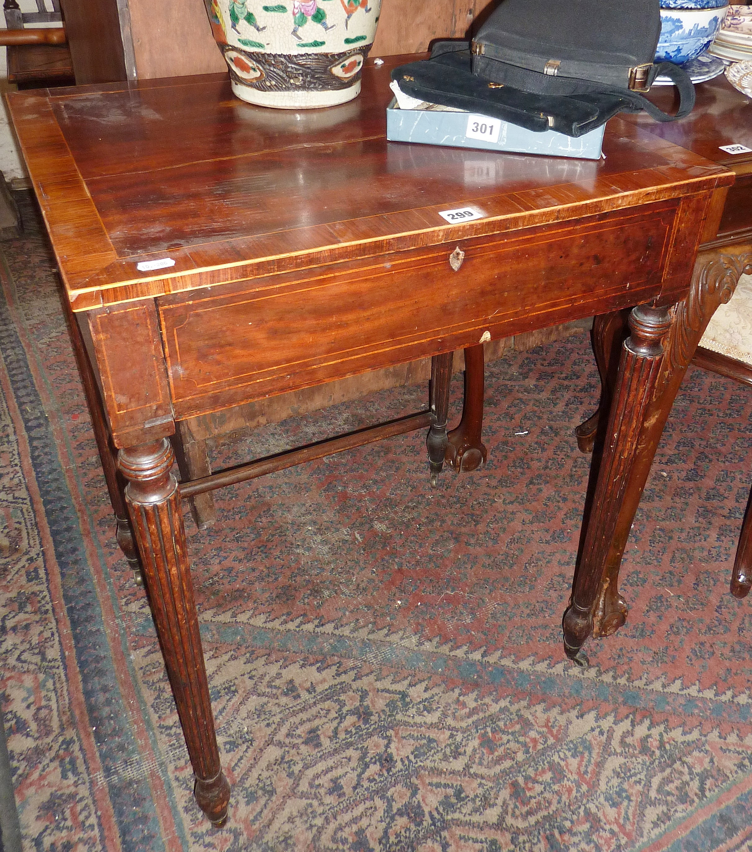 Lot 299 - 19th c. cross banded mahogany ladies writing table with single drawer having fitted interior above